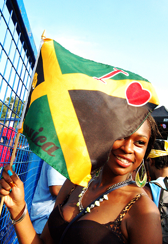 Celebrating at Scotiabank Toronto Caribbean Carnival, Caribana 2012. Woman holding I LOVED JAMAICA flag