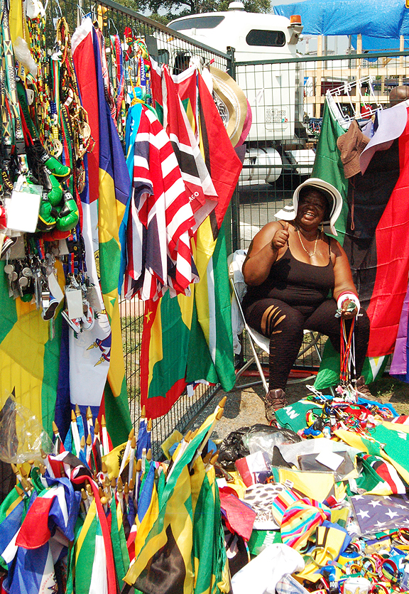 Older woman selling souvenirs for Caribana.