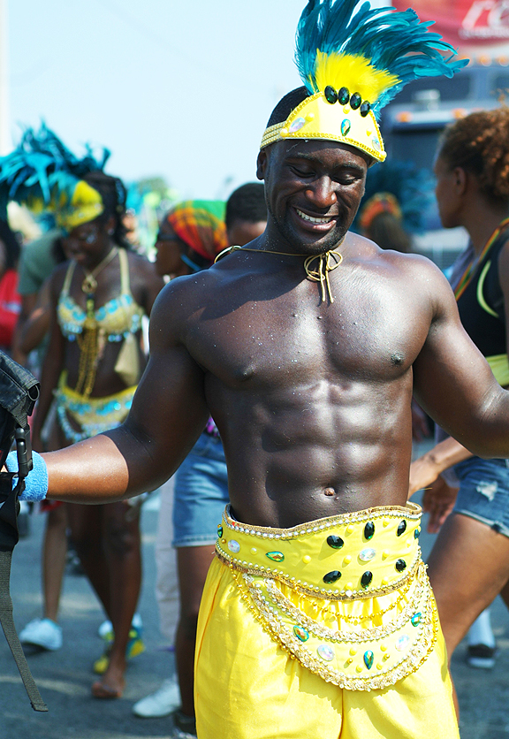 Good-looking male dancer participating in the parade.