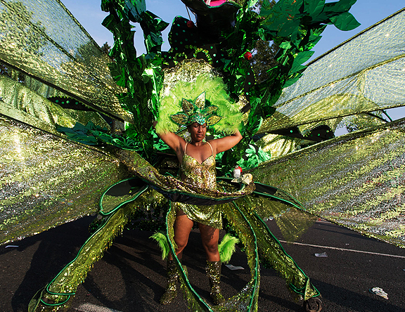 Woman all in green attached to her large float.