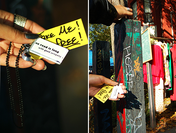 Hanging necklace on post in front of clothing store in Kensington Market, Toronto.