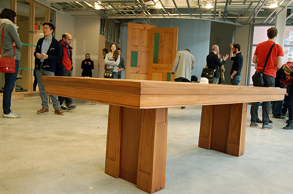 Table showcased at Public Displays of Affection with crowd of guests