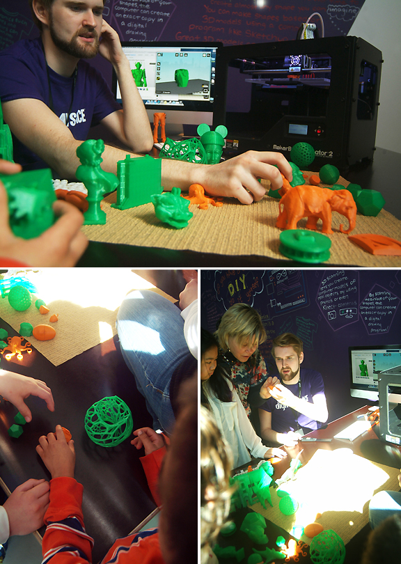 Images of kids playing with toys made by the 3D printer in the background