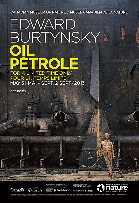 Poster for Edward Burtynsky: Oil at Museum of Nature with young man standing in front of beached oil tanker
