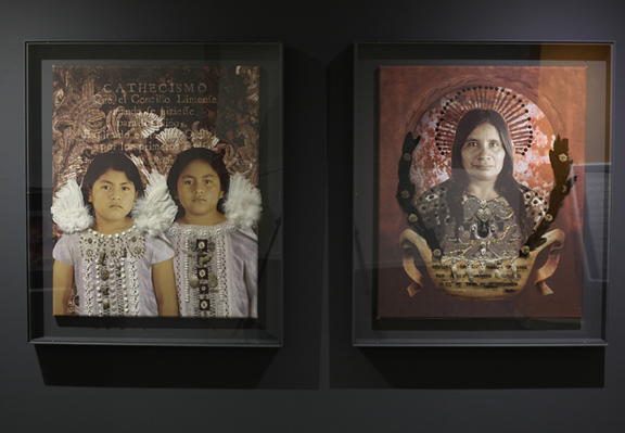 Two pieces of art work framed. On left photograph of two young girls with angel wings, on right photograph of older woman with halo, mixed media collage