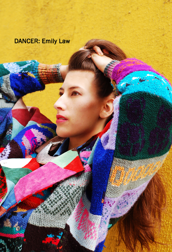 Profile of woman with long hair and patchwork jacket