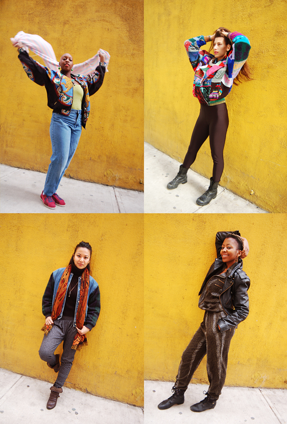4 young women posing against a wall