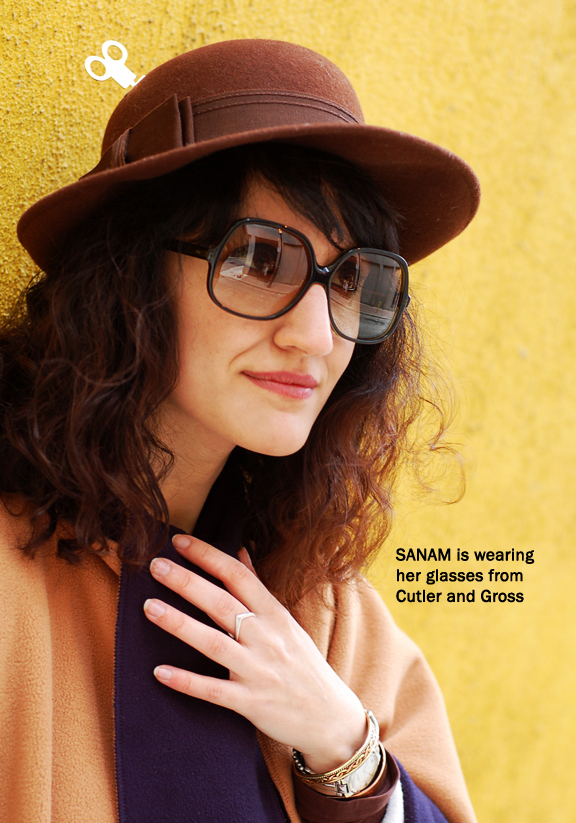 Upclose shot of woman wearing sunglasses and hat