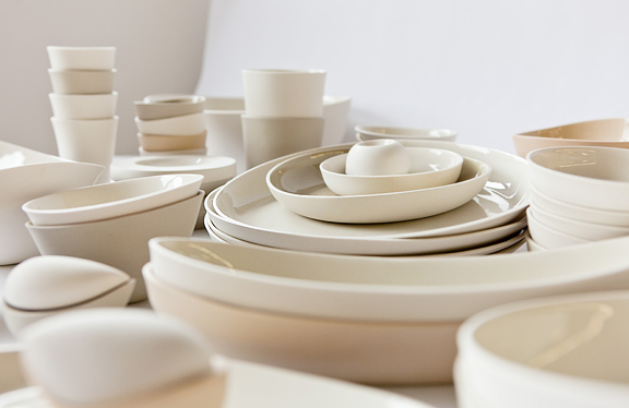 Large grouping of white bowls and plates