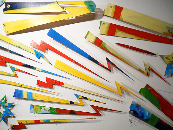 Brightly painted wood in the shape of thunderbolts