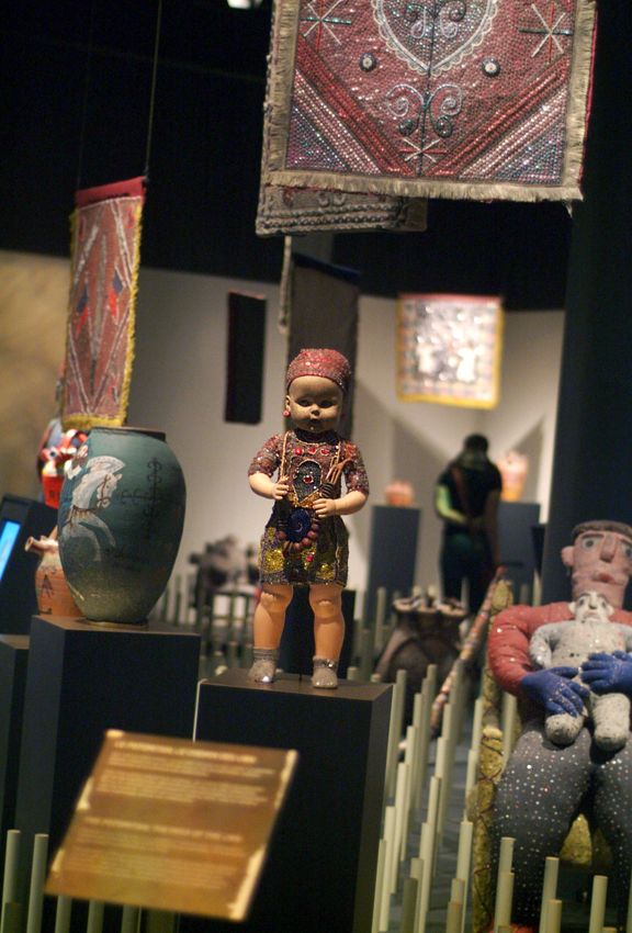 Exhibit space with sculptures that are part of Vodou traditions
