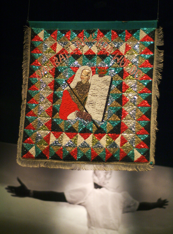 Embroidered tapestry with what looks like Moses holding 10 Commandments
