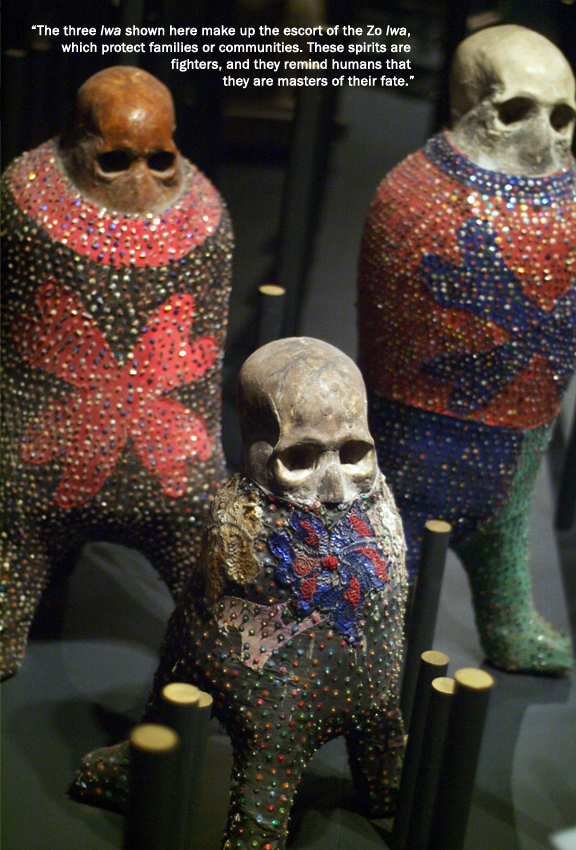 3 figures with skulls on top and decorated with metal and beads