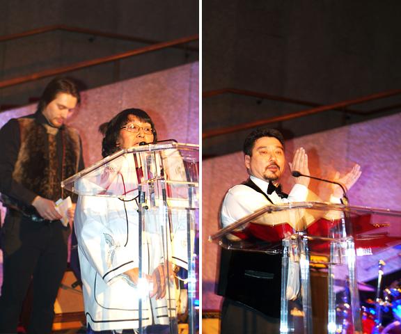 Female Inuk Elder praying at Podium and Inuk man speaking