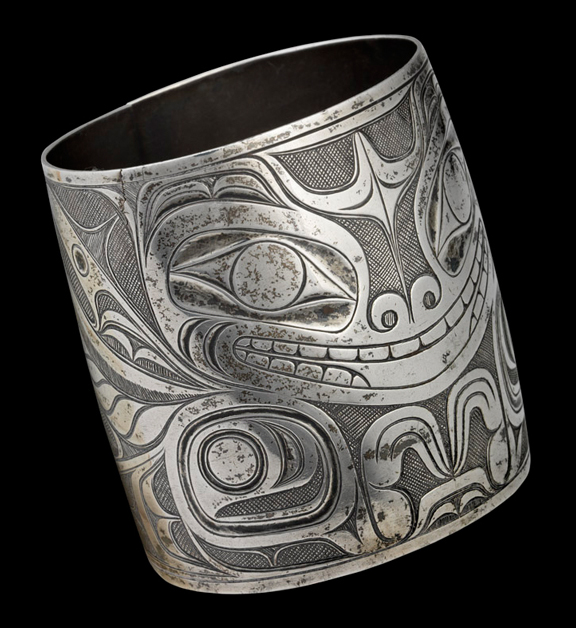 Silver bracelet with Haida carvings