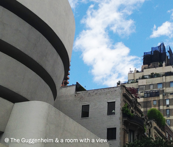 Skyscape of modern buildings with older style architecture, the profile of the Guggenheim