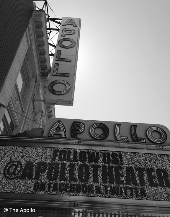 The outside of a theatre with the marquee and sign saying Apollo