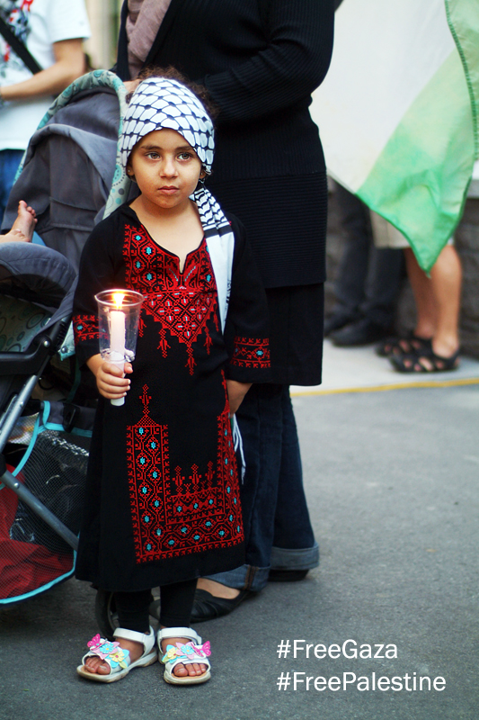 Little Palestinian girl holds candle