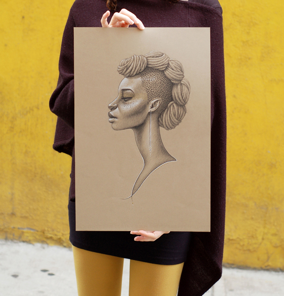 Young white woman holding a stylized drawing of a black woman, she is in front of a yellow stucco wall