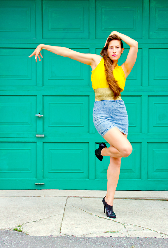 Female dancer posing in front of garage door