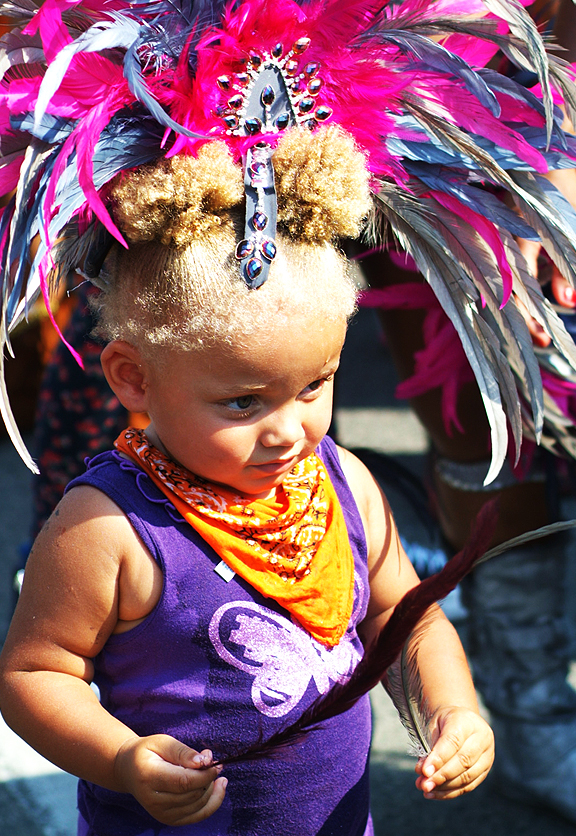 Adorable little girl wearing the feather headdress.