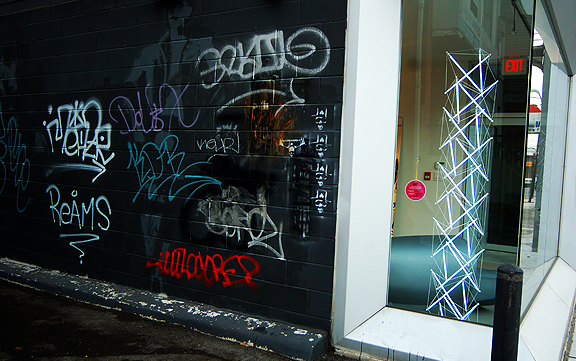 Store front along Dundas West for DO Design along with graffiti on an alley wall.