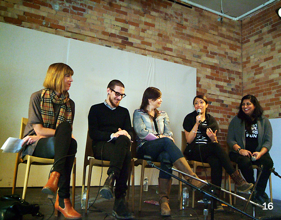 Five panelists sitting with mics to talk about design in front of a brick wall