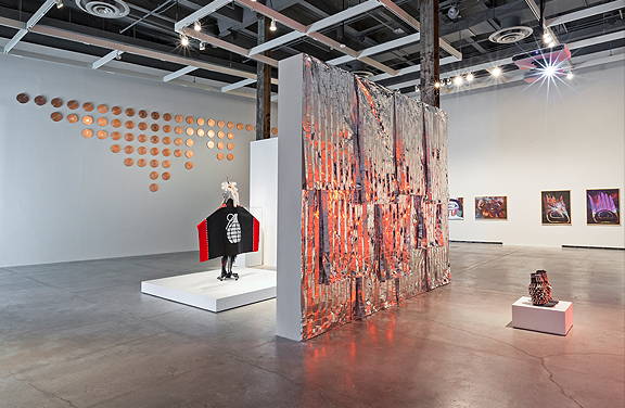 Contemporary Aboriginal art in a large gallery space with white walls