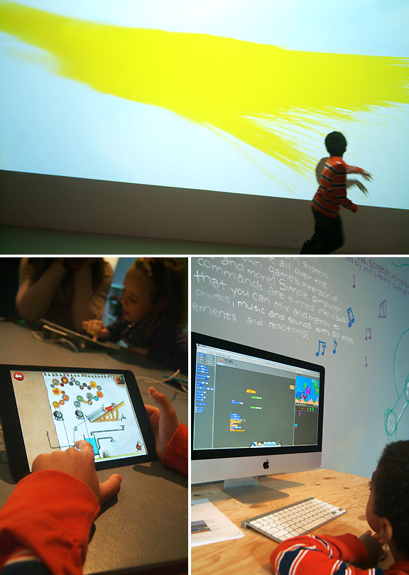 Young boy playing with interactive screen, ipad and computer