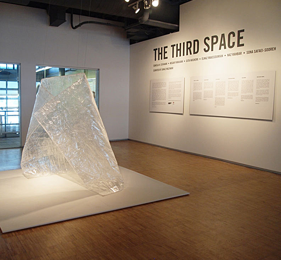Image of sculpture made from bubble wrap and words on wall behind it saying The Third Space