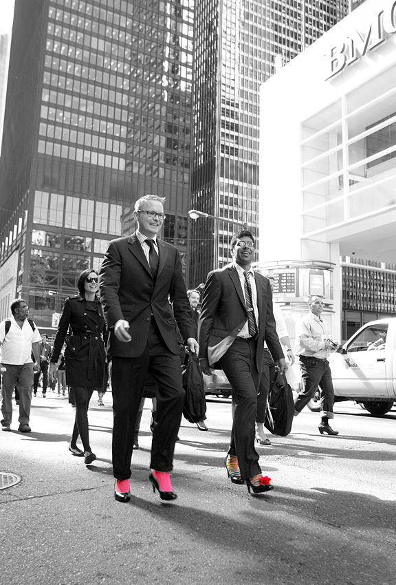 Men in suits walking in the middle of street with heels on