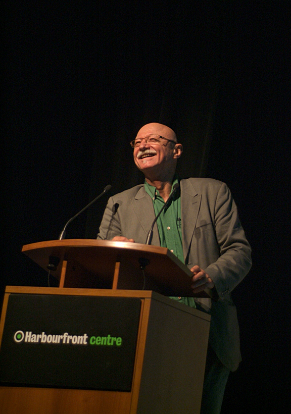 Man smiling while standing at a podium