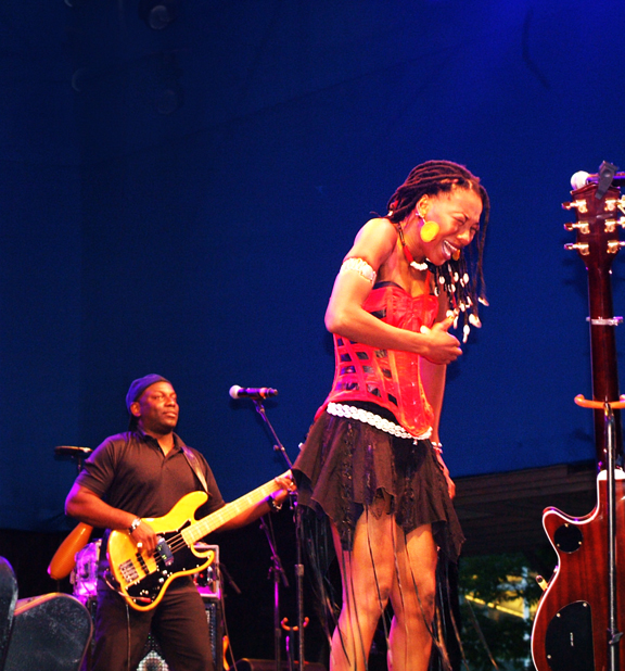 Image of female singer in African and western style outfit