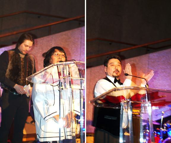 Female Inuk Elder praying at Podium and Inuk man speaking