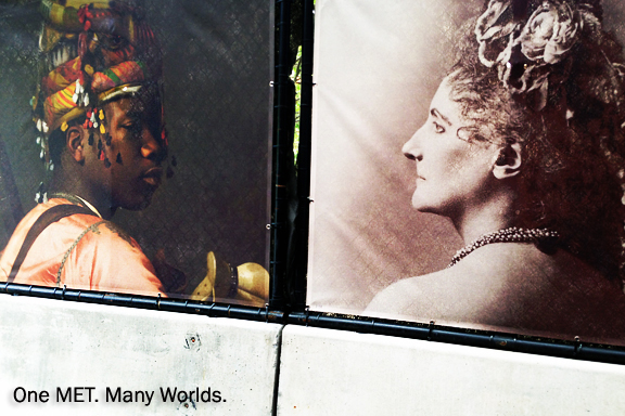 Poster advertising for the Metropolitan Museum, old painting of a young black man with ornate headdress facing an antique photograph of a middle age white woman