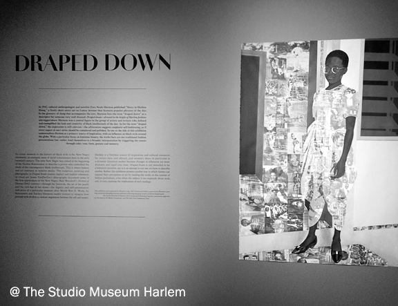 words on a wall that say Draped Down and a reproduction of a mixed media of a young black woman