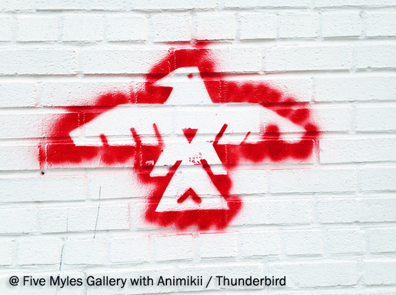 Spray painted outline of a motif that is an Ojibwa Thunderbird