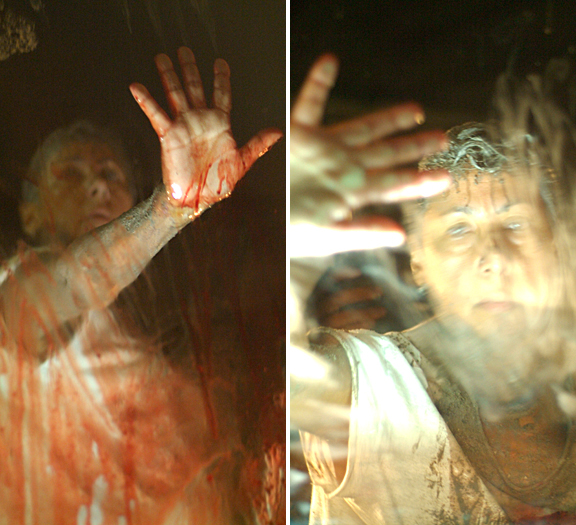 Woman pressing her bloody hand against a window, see her face through the glass